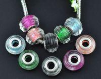 Perles Lampwork , perles de Murano et argent  15 x 9 et trou 4.5 X 10