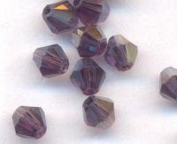 Toupies en crystal 4mm  Violet fonce AB X 100