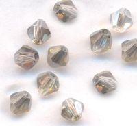 Toupies en crystal 4mm  X 100