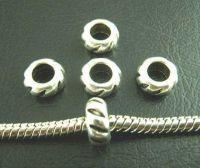 Intercalaires rondes  9mm  ..taille du trou = 5 mm X 10