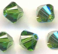 Toupies en crystal 4 mm fern green AB X 100