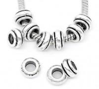 Intercalaires perles  9 x 5..taille du trou = 3.2 mm X 10