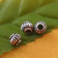 Intercalaire lanterne 5 mm argent tibétain  taille du trou = 1.5 mm Qte: 10
