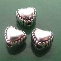Intercalaires cœur d'argent tibet 5x4 mm taille du trou = 1.5 mm Qte : 10