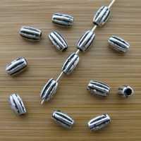 Intercalaires tubes  argent tibétain 8x4 mm  taille du trou = 2 mm Qte : 10