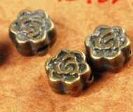 Intercalaires Fleur Bronze Antique 5 x 5mm  taille du trou = 1 mm Qte:10