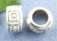 intercalaires fleur motif 4 X 7 mm  argent taille du trou = 4 mm x 10
