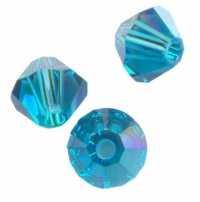 TOUPIES SWAROVSKI®ELEMENTS 6 mm  BLUE ZIRCON AB Qte : 50