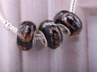 Perles Lampwork , perles de Murano et argent    15 x 9 et trou 4.5.... X 10  Perles