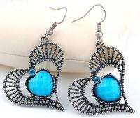 Boucles d'oreilles coeur en cristal et argent du Tibet