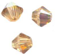 Toupies en crystal 4 mm Light col topaz X 100
