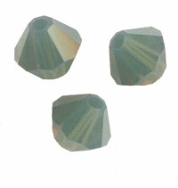 TOUPIES SWAROVSKI® ELEMENTS<br />  6 mm  <br /> PALACE GREEN OPAL<br />  X 12 perles