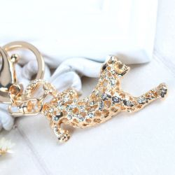 Leopard (anneau + pince accroche sac , ceinture) 7 x 3.5 cm
