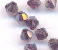 Toupies en crystal 4 mm Dark violet AB X 100