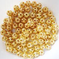 Perles boules Scintillantes or 4mm  taille du trou = 0.8 mm X 10