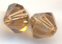 Toupies light smoked topaz 4 mm